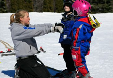 An instructor teaches techniques to two children at Blue Mountain Resort