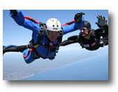 An experienced skydiver teaches a student how to skydive at Skydive Superior.