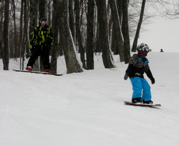 Two snowboarders at Porcupine Mountains