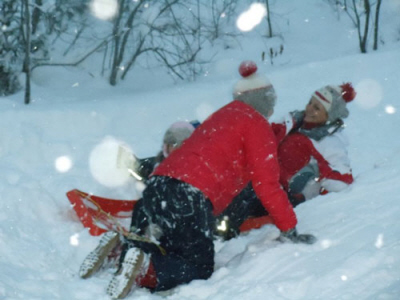 Two kids play in the snow at Porcupine Mountain