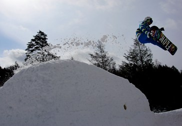 A snowboarder gets some air at Blue Mountain Resort