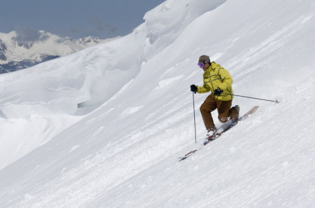 A skier goes down a steep mountain at Arapahoe Basin