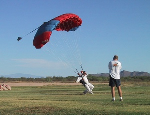 A student skydiver at Skydive Phoenix lands while an instructor observes