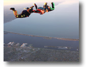 An experienced skydiver teaches a student how to skydive at Skydive Superior