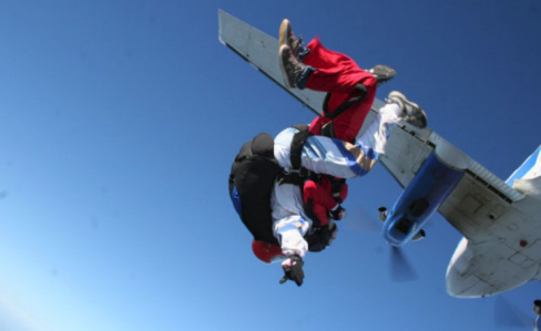 No Limits Skydiving - Tandem skydivers after jumping from the airplane