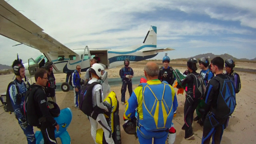 Many skydivers gather to discuss the jump before entering the airplane