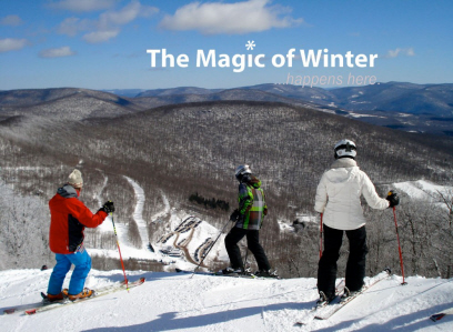 The magic of winter...happens here. Three skiers head down the top of the mountain