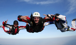Two accelerated freefall instructors at Skydive Moab train a student on how to skydive
