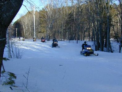 Snowmobiles in The Porkies
