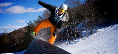 A snowboarder boards over an obstacle at Blue Mountain Resort